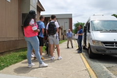 Students wait in line to explore the van